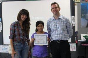 Ryan Holbrook and entrepreneur Katrina Salazar award attendee Jaylin V. her certificate.